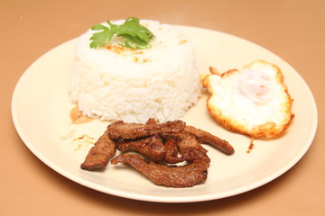 Thailand style fried rice, fried meat with garlic, pepper, put a fried egg.