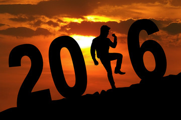 Person celebrating new year with 2016 number