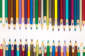 Close up set of multiple colour wooden pencils on white background