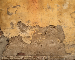 Fotobehang Oude vuile getextureerde muur Texture of old wall covered with yellow stucco