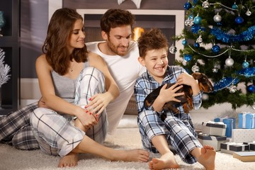 Happy family with puppy