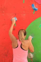 Girl climbing a rock wall
