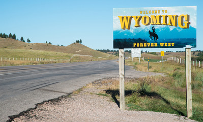 Highway sign indicating the border of Wyoming, looking east from South Dakota on Highway 24 (Wyoming)/Highway 34 (South Dakota)