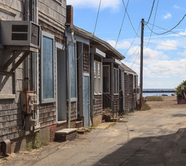 Provincetown, Massachusetts, Cape Cod cottages on the pier with the ocean straight ahead.