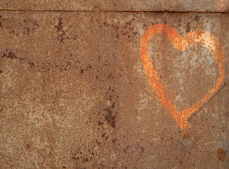 Texture of rusty metal wall with picture shaped heart