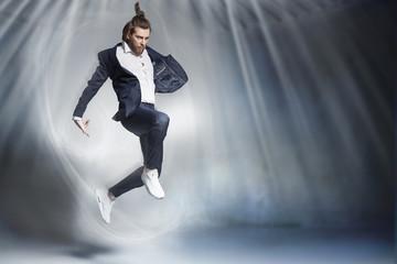 Handsome jumping businessman wearing elegant stuff