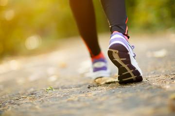 Runner feet running on road