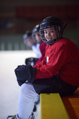 children ice hockey players on bench