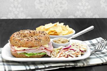Ham and Swiss Cheese Sandwich on a multi grain bagel.
