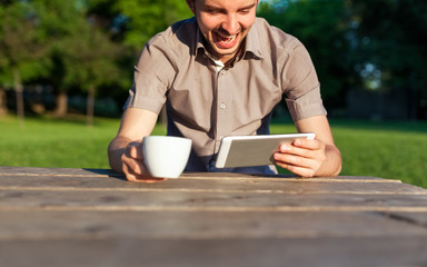 Happy man uses a new Tablet PC