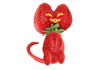 Creative food concept. Little kitten made from strawberries