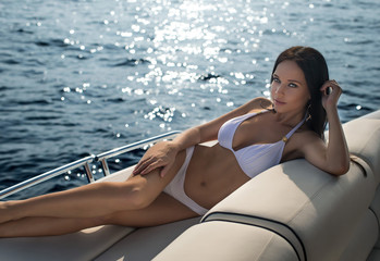 Beautiful girl in a white swimsuit