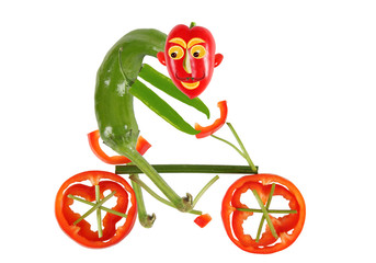 Healthy eating. Funny little  pepper  on a bicycle