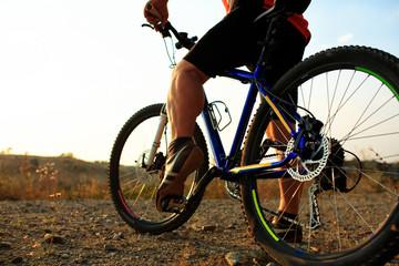 low angle view of cyclist riding mountain bike