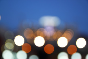 abstract image of blurred night city background with circle lights