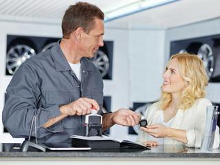 Customer and mechanic in a garage