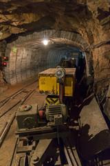 Underground tunnel of Limestone mine with train and locomotive in Bohemia, Czech Republic