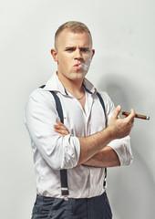Handsome fashion man smoking cigar
