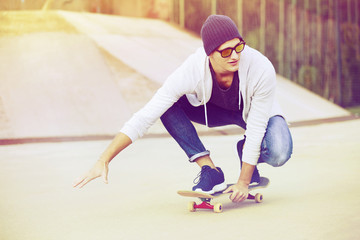 Teen boy riding skateboard