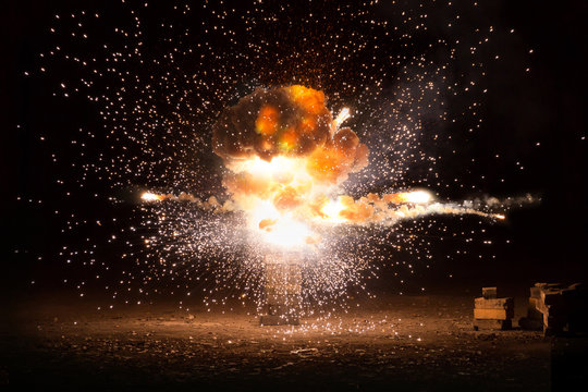 Realistic fiery explosion busting over a black background