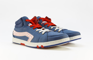 Sports shoes with red laces on a white background