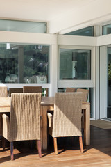 veranda, wicker chairs and wooden table