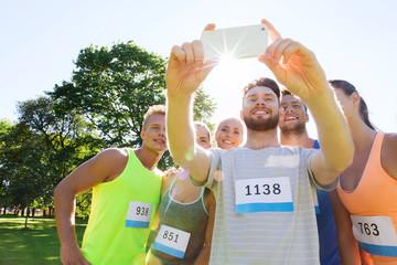 teenage sportsmen taking selfie with smartphone