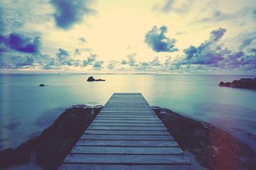 Wooden pier or jetty on a blue ocean