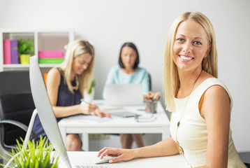 Smiling women working in the office