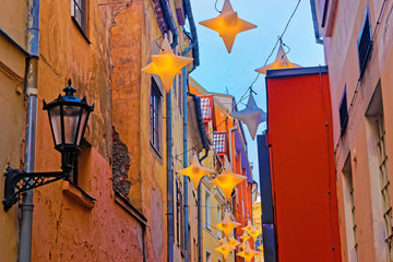Illuminated street in old part of Riga