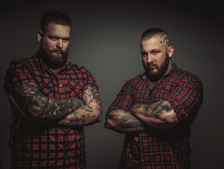 Two brutal mans with beards.