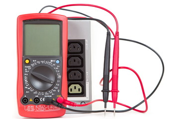 Red multimeter and UPS (uninterruptible power supply)