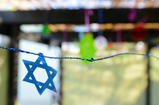 Star of David decorations inside a Jewish family Sukkah