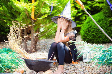 Wall Mural - Adorable little girl wearing witch costume on Halloween outdoors