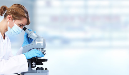 Doctor woman with microscope.