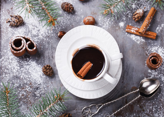 Hot chocolate on Christmas day with the aroma of cinnamon.