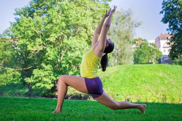 Poster Ecole de Danse young woman doing yoga exercises in park - crescent moon pose