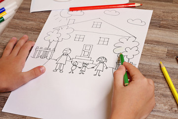 Kid painting. Boy coloring. Child Painting family and home. Happy family concept. Selective focus image. Focus on picture