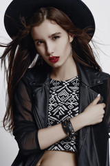 Fashion style portrait of young pretty stylish girl