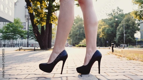 Sexy Woman Legs In Black High Heels Shoes Walking In The City Urban Street Steadicam Stabilized Shot In Slow Motion Lens Flare