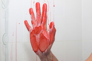 Bloody hand in bathroom