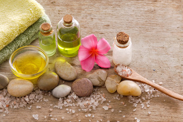 wooden background –orchid , stones, candle, oil and pile of salt,towel