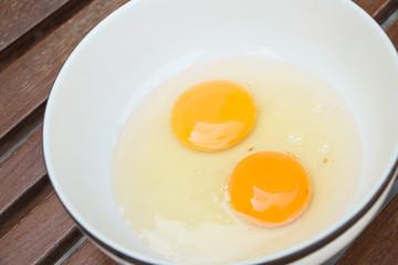 raw egg yolk on the dish on table