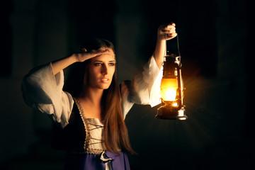 Beautiful Medieval Princess Holding Lantern Looking Outside