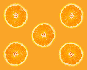 segments of an orange on orange background