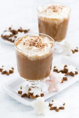 festive pumpkin latte and almond biscuits, vertical
