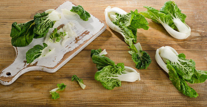 Chinese cabbage, Bok Choy on a wooden background.