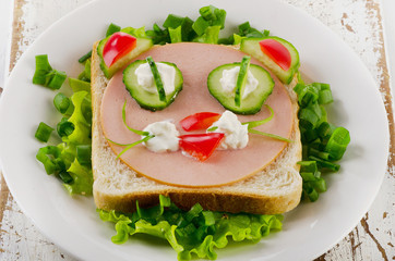 Breakfast with smiling toast and fresh vegetables. Top view