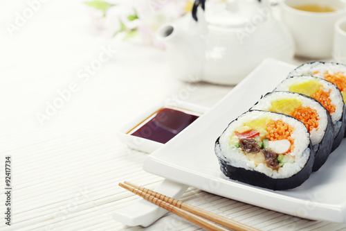sushi set green tea and sakura branch stockfotos und lizenzfreie bilder auf. Black Bedroom Furniture Sets. Home Design Ideas