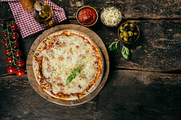 Home baked margarita pizza with ingredients
